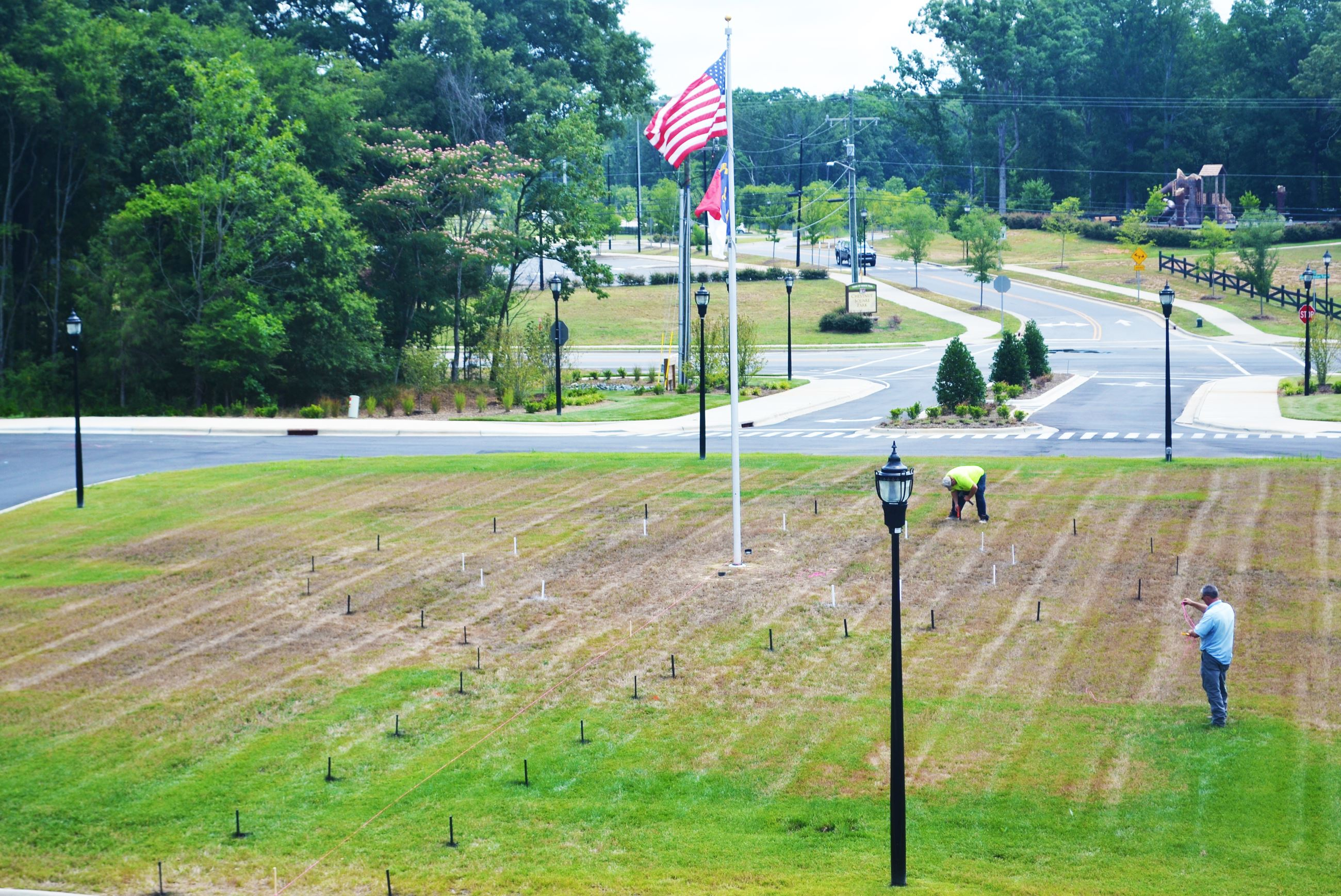 Town staff begins work marking the location of the Veterans Memorial