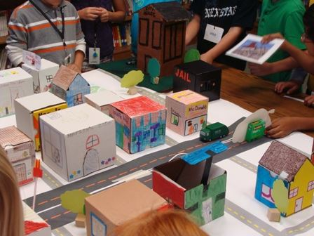 Physical subdivision map of cardboard houses